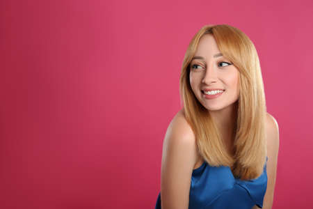 Photo for Beautiful young woman with blonde hair on pink background. Space for text - Royalty Free Image
