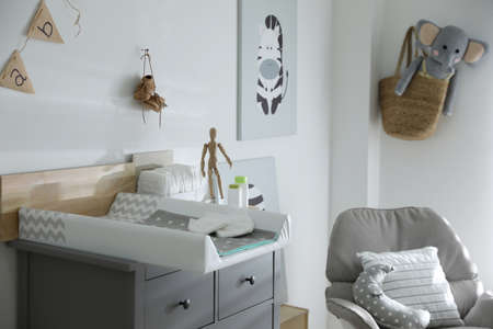 Photo pour Modern changing table in baby room interior - image libre de droit