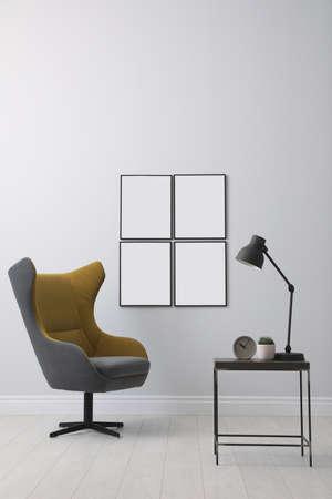 Foto de Stylish room interior with empty posters on wall. Mockup for design - Imagen libre de derechos