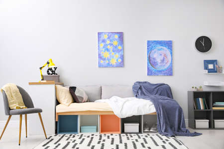 Photo pour Modern teenager's room interior with comfortable bed and stylish design elements - image libre de droit