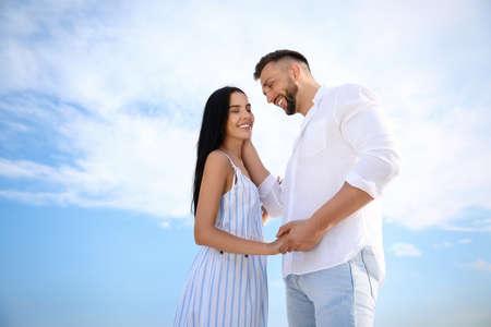 Foto de Happy young couple on sunny day. Beach holiday - Imagen libre de derechos