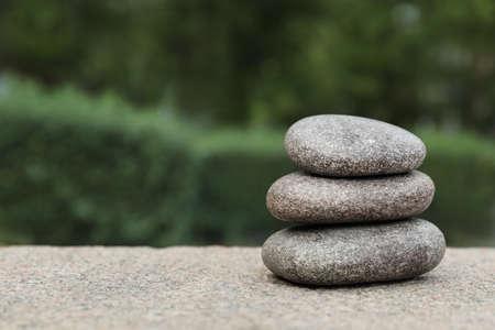 Photo pour Stack of spa stones outdoors, closeup. Space for text - image libre de droit