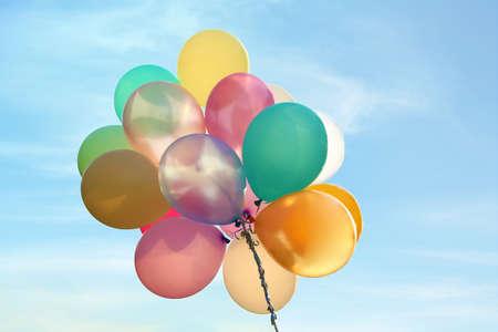 Photo pour Bunch of bright balloons in blue sky - image libre de droit