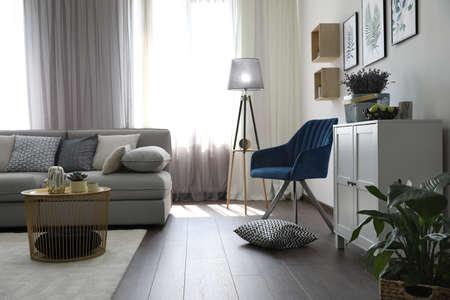 Photo pour Elegant living room with comfortable sofa and armchair near window. Interior design - image libre de droit