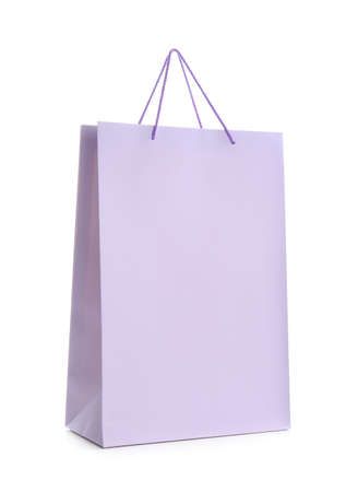 Photo pour Lilac paper shopping bag isolated on white - image libre de droit