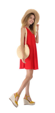 Photo pour Young woman wearing stylish red dress on white background - image libre de droit