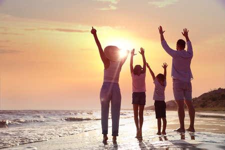 Photo for Family on sandy beach near sea. Summer vacation - Royalty Free Image