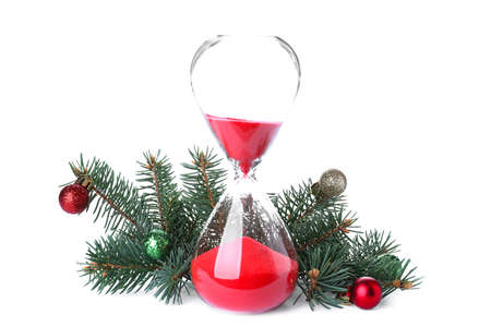 Photo for Hourglass, fir tree twigs and decor on white background. Christmas countdown - Royalty Free Image