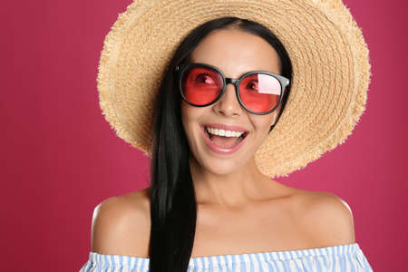 Photo for Beautiful woman wearing sunglasses on pink background, closeup - Royalty Free Image