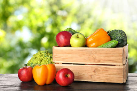 Photo for Wooden crate with fresh vegetables and fruits on table against blurred background - Royalty Free Image