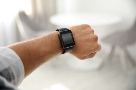 Photo for Man with smart watch on blurred background, closeup - Royalty Free Image