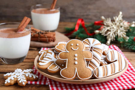 Photo for Delicious gingerbread Christmas cookies on table, closeup - Royalty Free Image