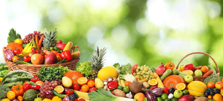 Photo for Assortment of fresh organic vegetables and fruits on blurred green background - Royalty Free Image