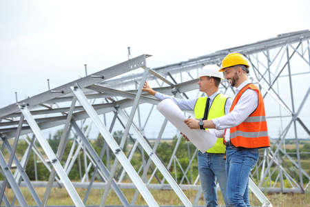 Photo pour Professional engineers working on installation of electrical substation outdoors - image libre de droit