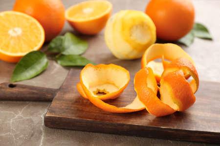 Photo for Orange fruit peel on grey marble table - Royalty Free Image