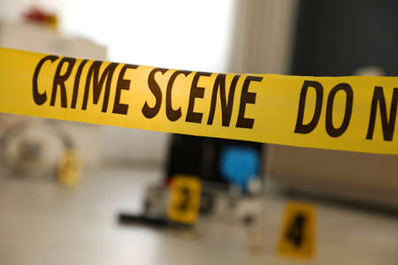 Photo for Crime scene with evidences and criminologist case, focus on yellow tape - Royalty Free Image