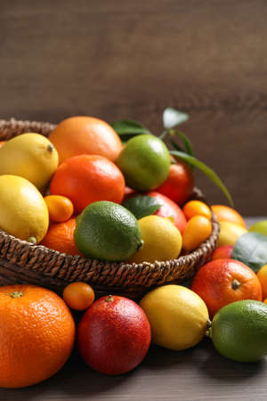 Photo for Different ripe citrus fruits on wooden table - Royalty Free Image