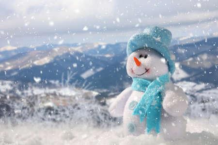 Photo pour Cute small decorative snowman outdoors on sunny day, space for text - image libre de droit
