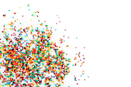 Photo pour Colorful sprinkles on white background, top view. Confectionery decor - image libre de droit