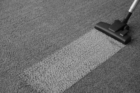 Photo pour Modern vacuum cleaner on carpet. Space for text - image libre de droit