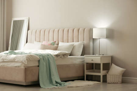 Photo for Stylish room interior with large comfortable bed - Royalty Free Image