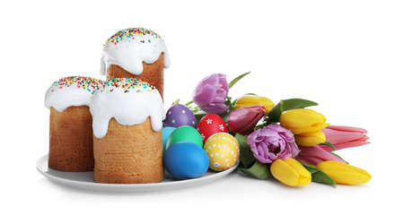 Photo for Traditional Easter cakes, tulips and colorful eggs on white background - Royalty Free Image