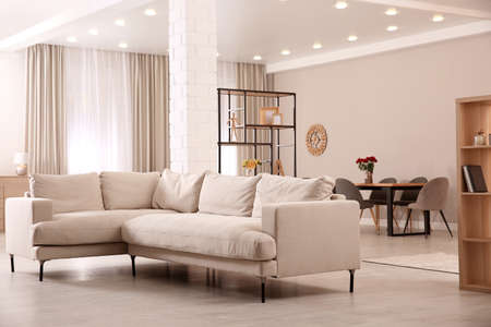 Photo for Modern living room interior with comfortable sofa and wooden table - Royalty Free Image