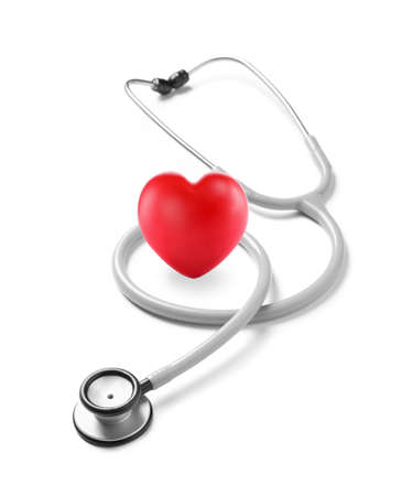 Photo pour Stethoscope and red heart on white background - image libre de droit