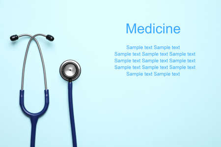 Photo for Stethoscope on light blue background, top view. Space for text - Royalty Free Image