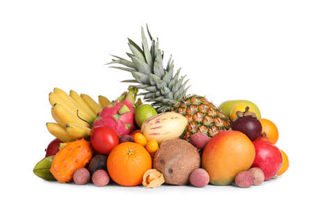 Different ripe exotic fruits on white background