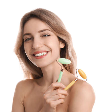 Photo pour Young woman with natural face rollers on white background - image libre de droit