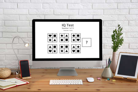 Photo pour Modern computer with IQ test on screen in office - image libre de droit