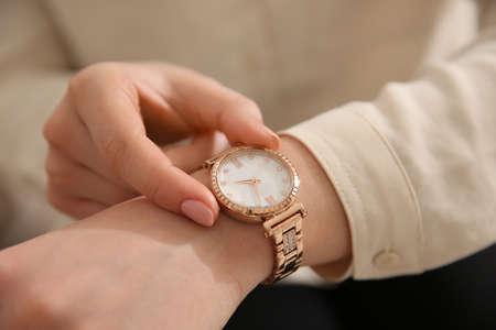 Photo pour Woman in casual shirt with luxury wristwatch, closeup - image libre de droit