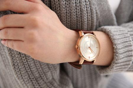Photo pour Woman in casual sweater with luxury wristwatch, closeup - image libre de droit