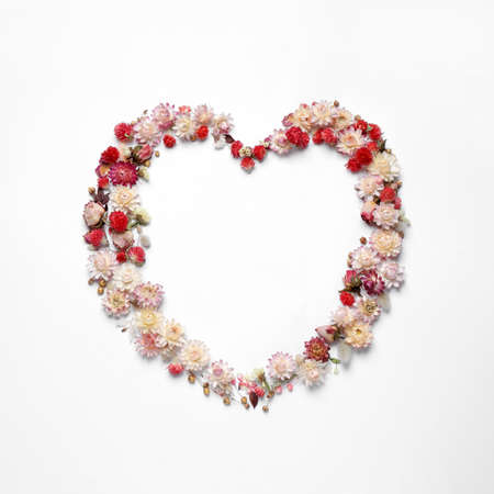 Photo for Beautiful heart shaped floral composition on light background, flat lay - Royalty Free Image