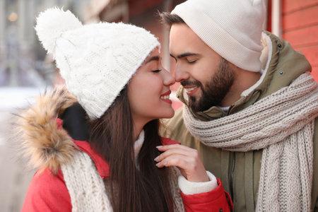 Photo pour Happy young couple spending time together at winter fair. Christmas celebration - image libre de droit