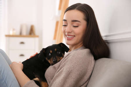 Photo pour Woman with cute puppy indoors. Lovely pet - image libre de droit