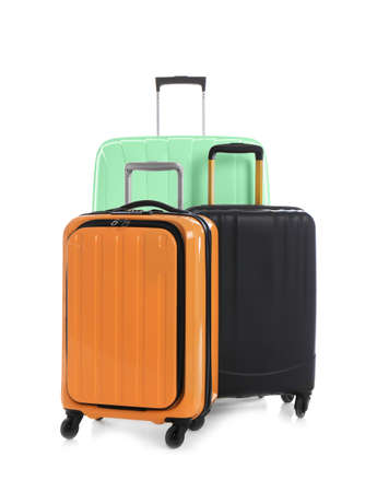 Photo pour Modern suitcases for travelling on white background - image libre de droit