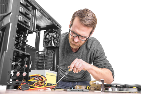 Photo for Computer repair. Computer technician working on a personal computer. - Royalty Free Image
