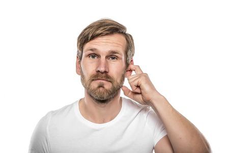 Foto für Man Scratching in His Ear. Isolated on white. - Lizenzfreies Bild