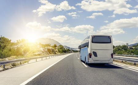 Photo pour Bus rushes along the asphalt high-speed highway. - image libre de droit
