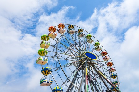 Photo for Colorful Ferris wheel against the blue sky. - Royalty Free Image