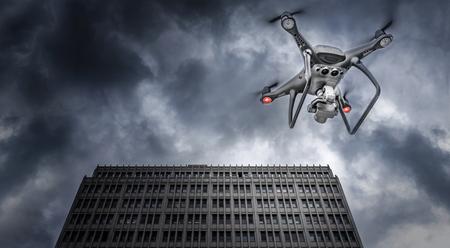 Photo pour Dark drone flies on the background of downtown skyscrapers. - image libre de droit