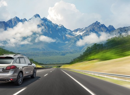 Photo for The car drives fast on the highway against the backdrop of a mountain range. - Royalty Free Image