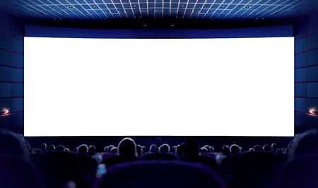 Foto de White screen in the cinema and the audience watching the movie. Cinema. - Imagen libre de derechos