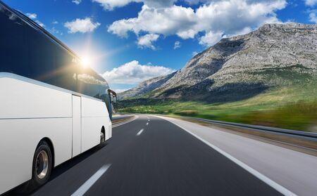 Photo pour Unbranded white bus rushes along a highway. - image libre de droit