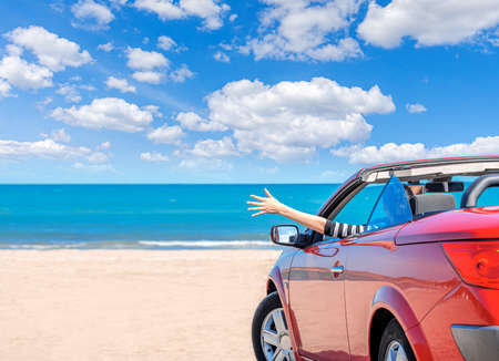 Foto de Red car on the beach. Vacation and freedom concept. - Imagen libre de derechos