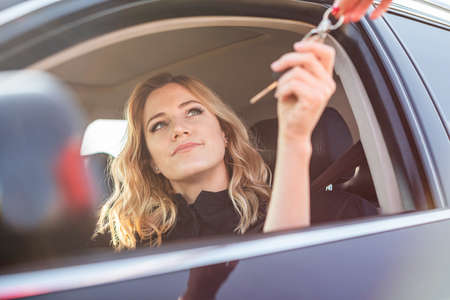 Photo for Beautiful woman gets the key from the car - Royalty Free Image
