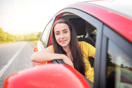 Photo for Happy beautiful woman is driving a car. - Royalty Free Image