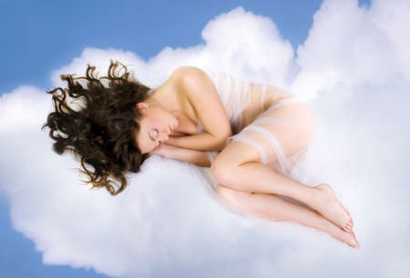 beautiful young woman lying on  clouds